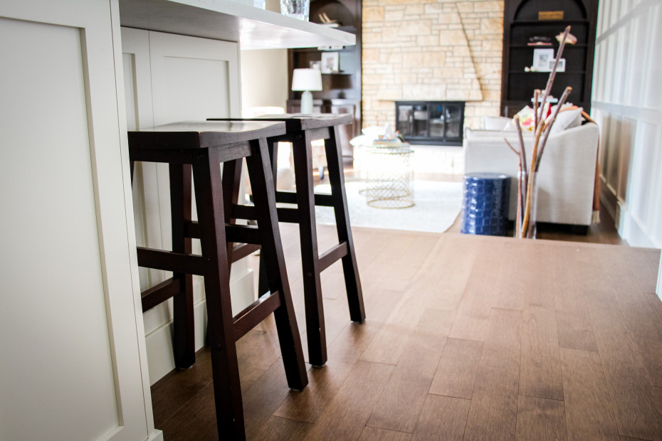 Rustic saddle stools expertly integrated into a modern classic kitchen.