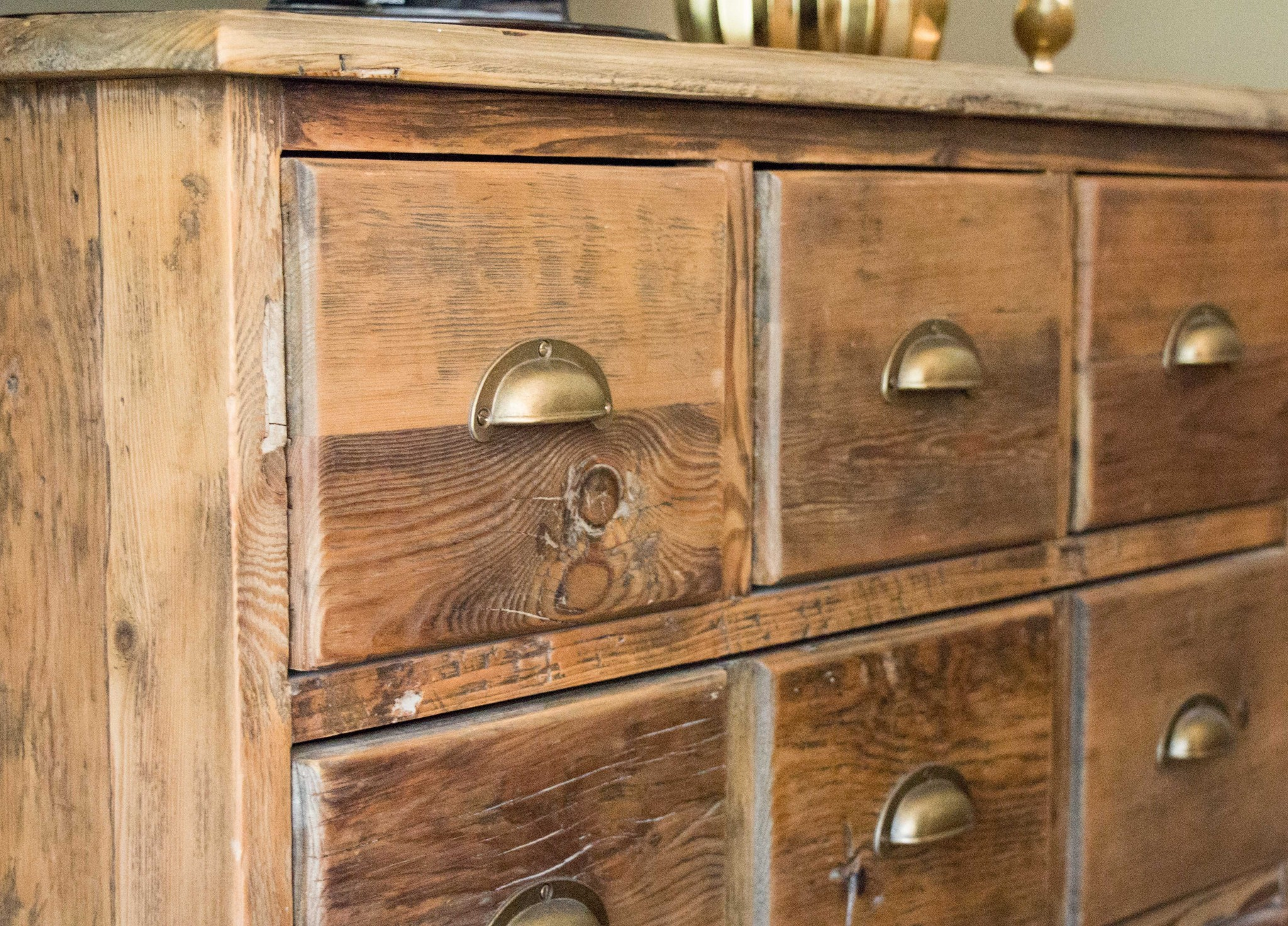 Closeup view of dresser with many small drawers