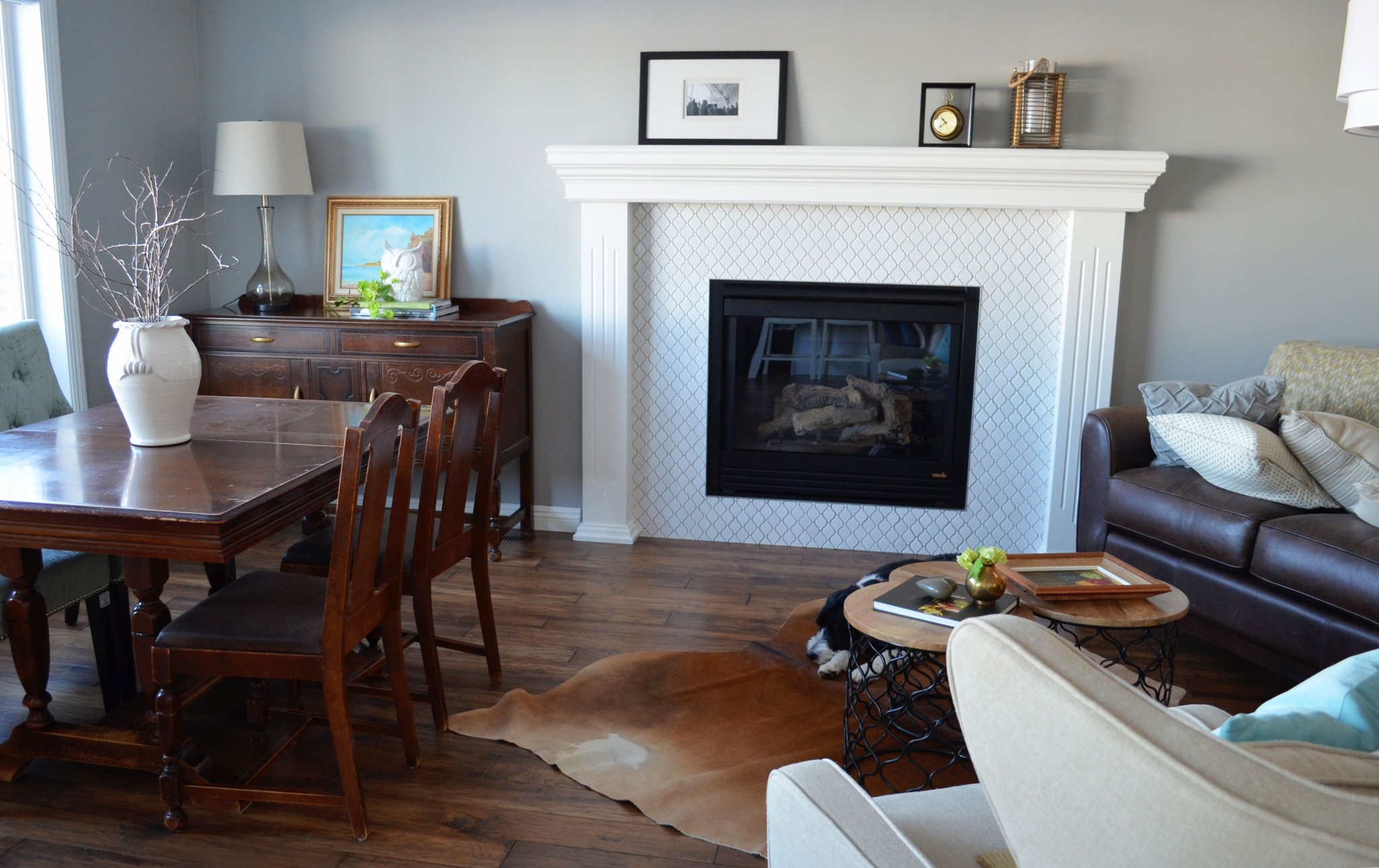 Transitional fireplace surround with modern white tile