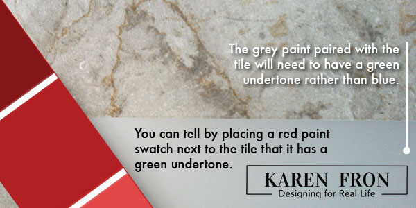 A red paint chip or swatch placed against a tile reveals it's green undertones.