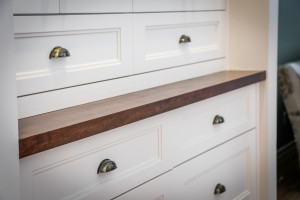 Built-in cabinetry with a rich natural wood countertop to give a furniture feel.