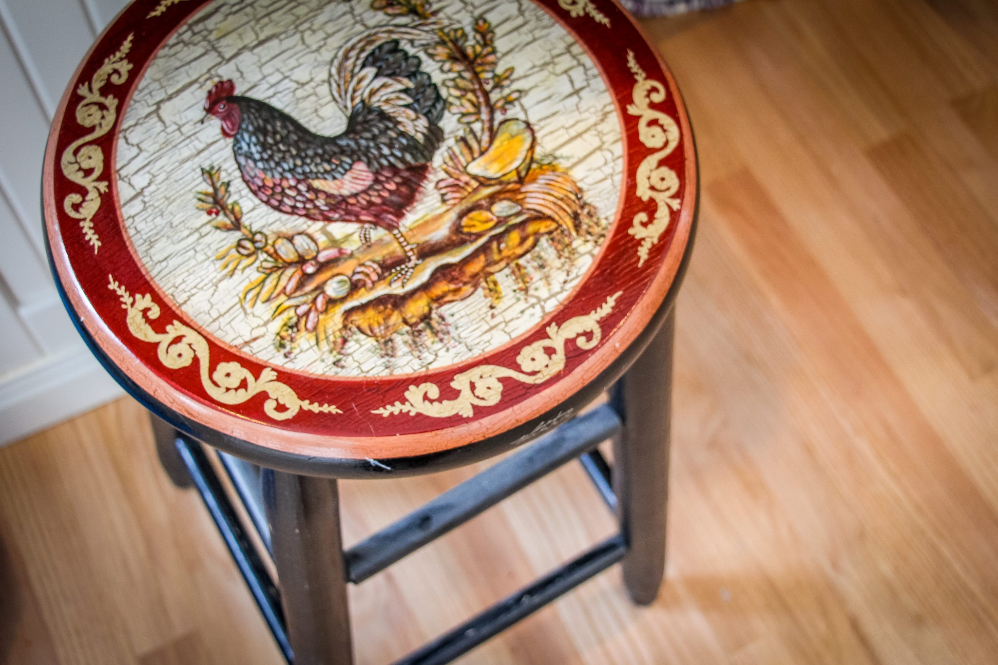 Country style stool with a hand painted rooster on the seat.