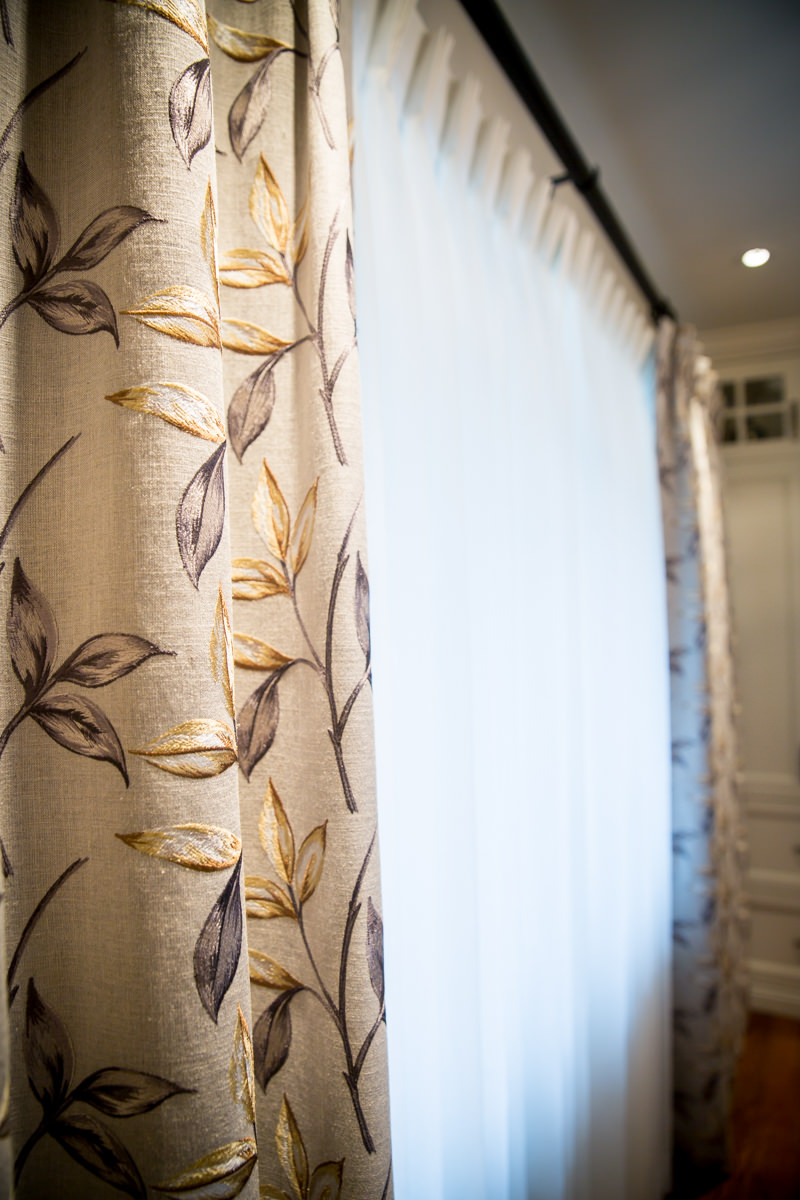 Custom draperies in an embroidered floral pattern.