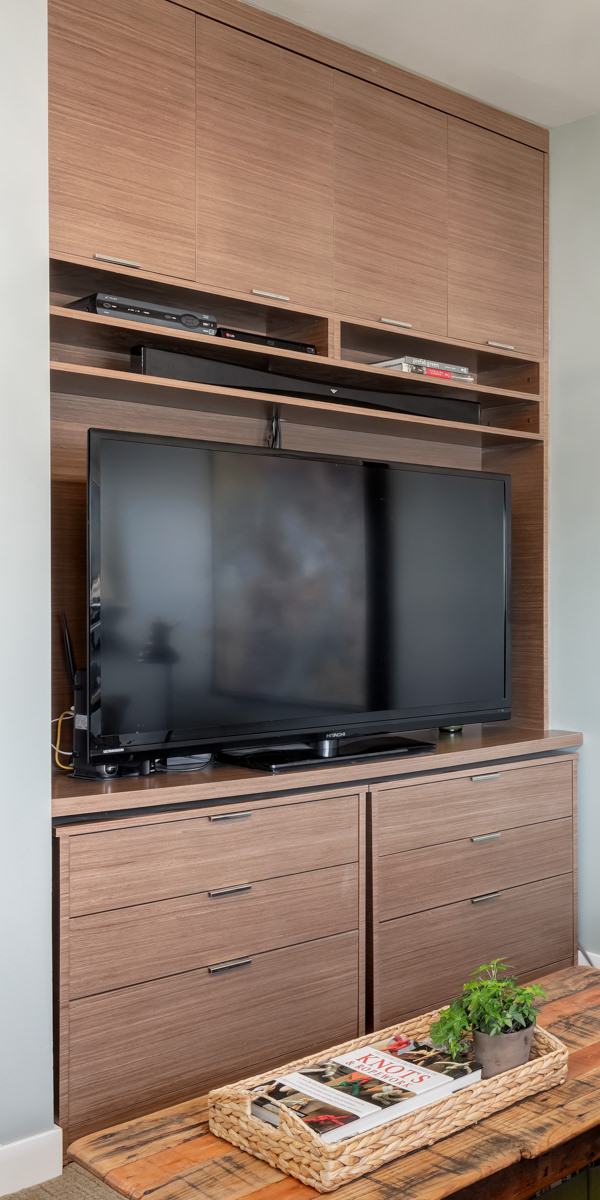 closeup of custom television unit that can do double duty as a desk or dresser.