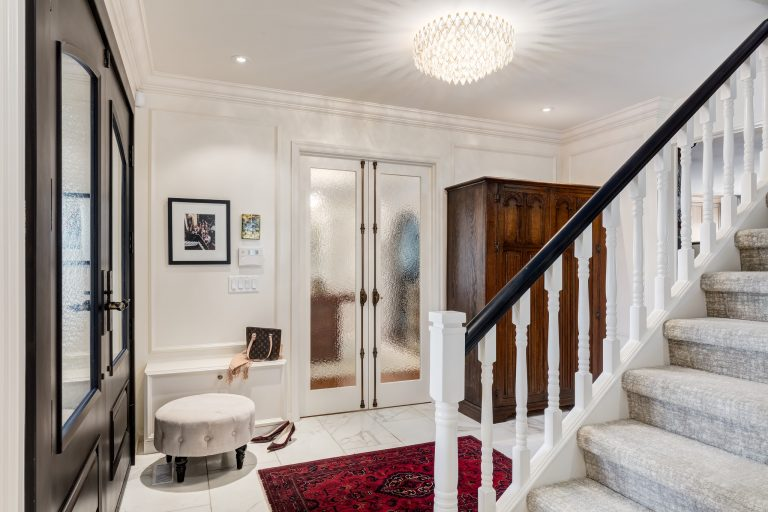 Newly renovated foyer looks stunning with marble floors, crimone bolts, antique wardrobe, antique persian rug and a touch of black