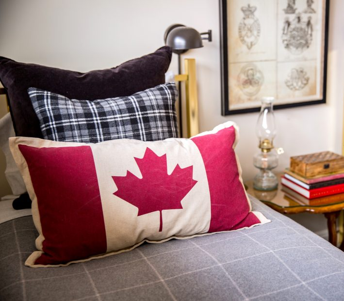 the small touch of a Canadian flag creates the decor of this boys room