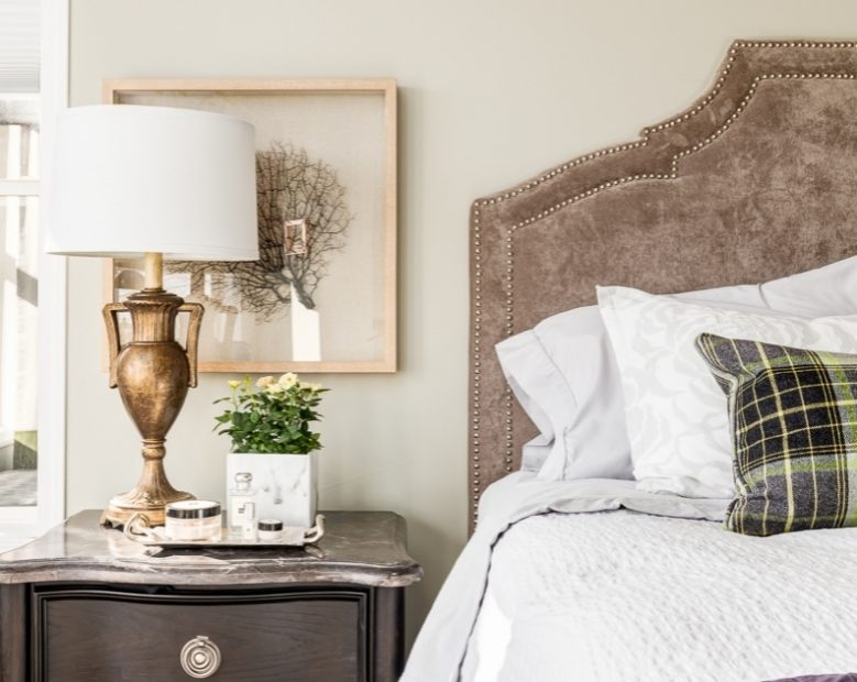 Custom fabric headboard with plaid cushion and vintage lamp from Banff Springs Hotel