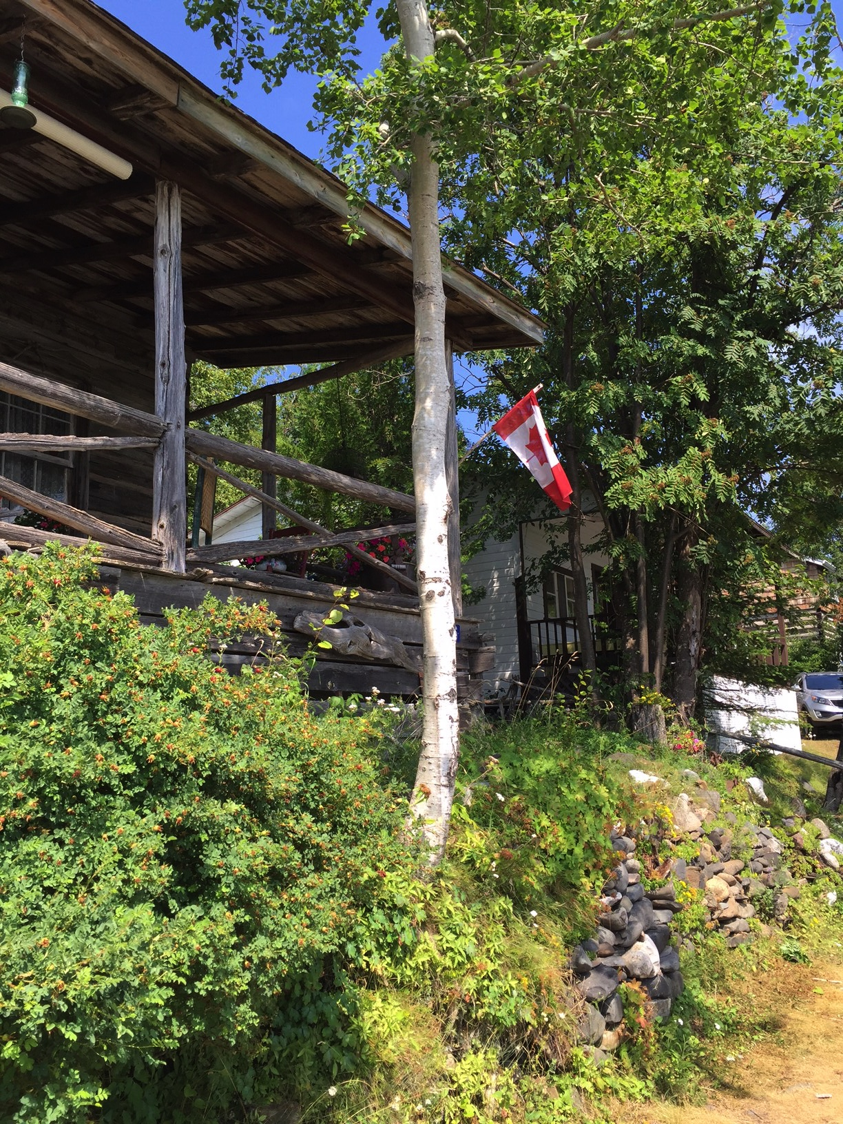 rustic cabin with Canadian flag