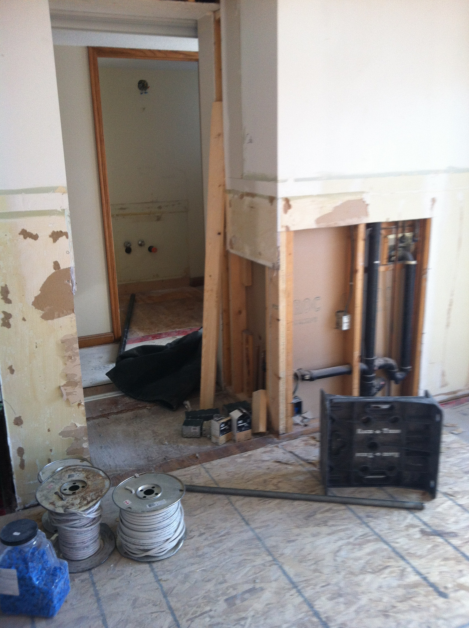 View of wet bar removed and plumbing section of wall