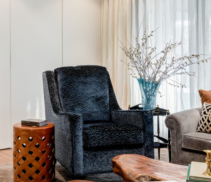 Navy blue chair sits proud and strong against panelled wall in BM OC-18 and Romo fabric shears.