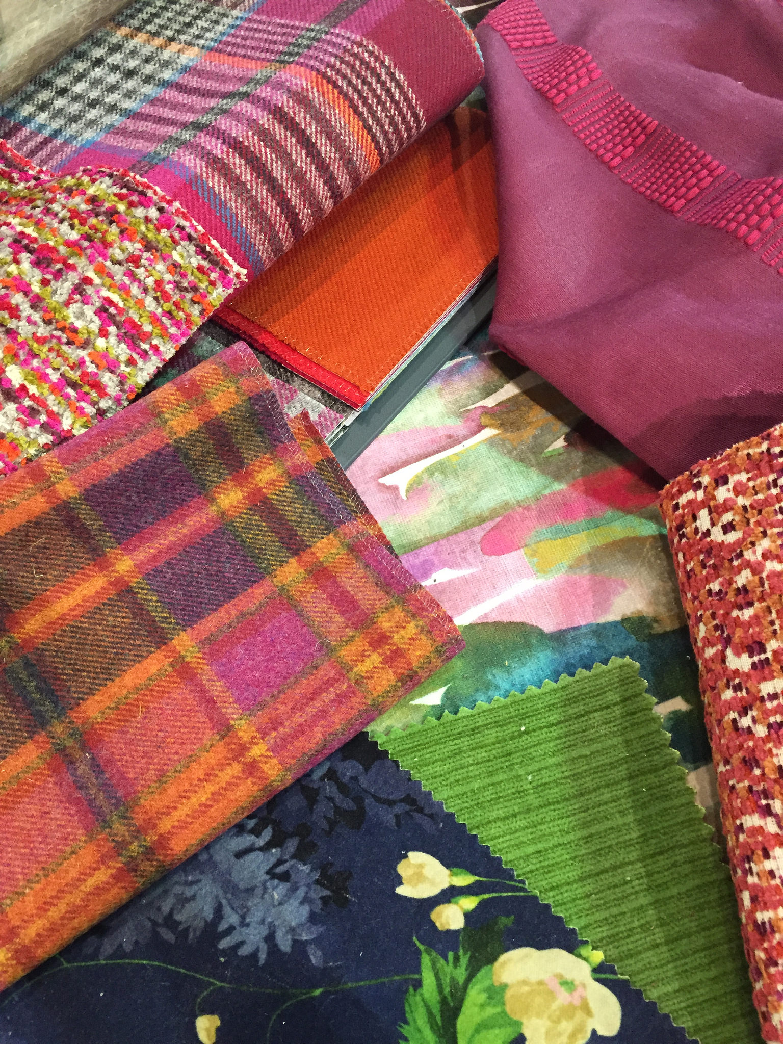 a selection of bright textiles work together to create a stunning palette
