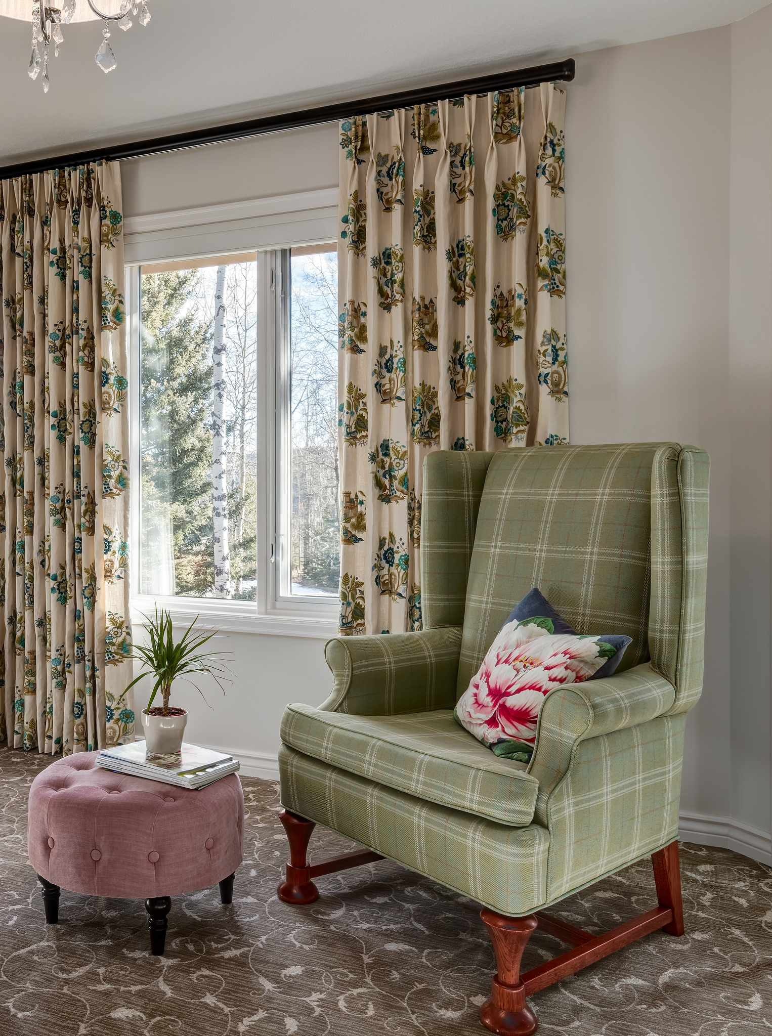 plaid chair in soft greens with a hint of pink accent nicely the colefax and fowler draperies and pattern wall to wall carpeting