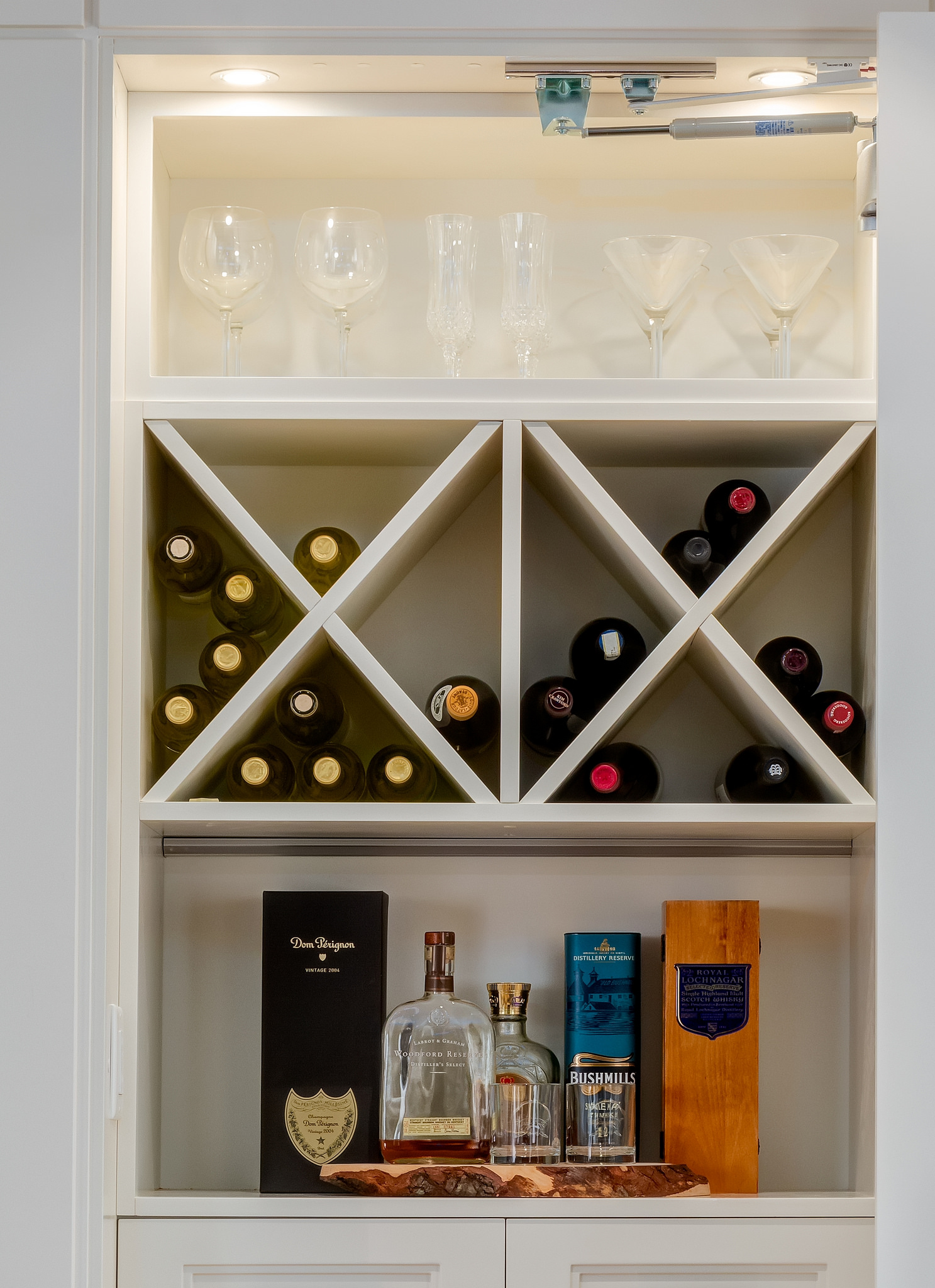Detail of custom bar that sits behind a panelled wall.