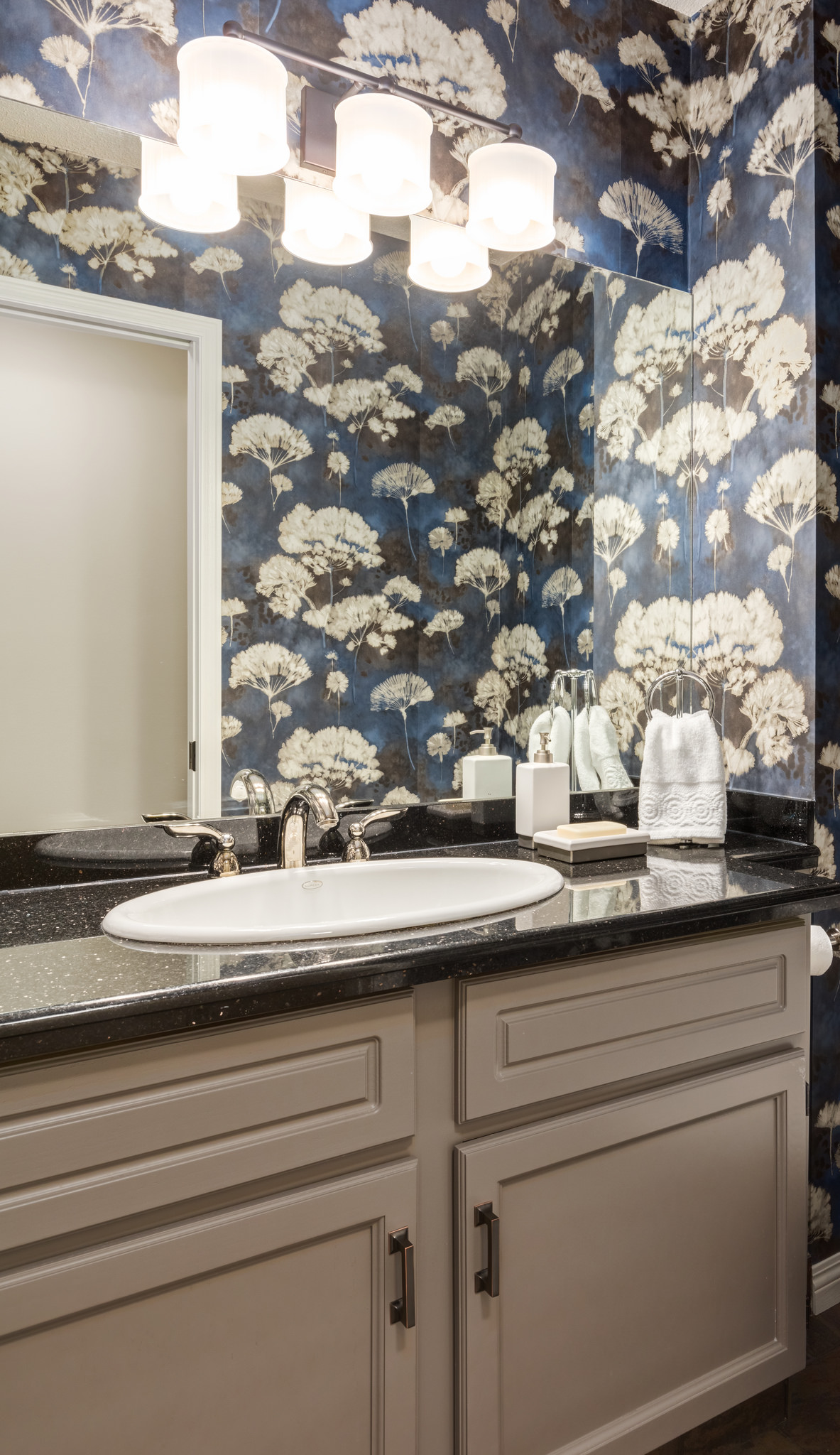 powder room refresh with wallpaper and painted cabinets