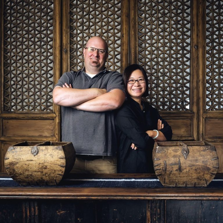 Miki Wu and John McHugh pose in their store