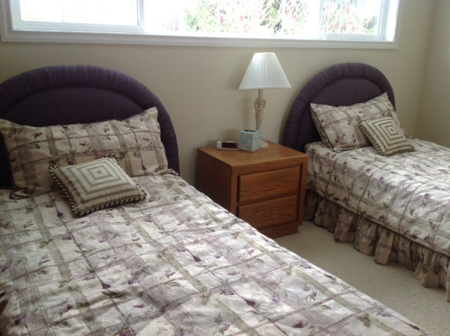 Dated bedroom with two twin beds before redecorating