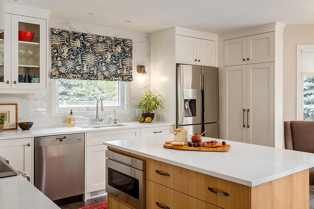 Monkey and fern themed blue and yellow fabric makes an interesting conversation piece as a valance over a bright remodelled kitchen window.