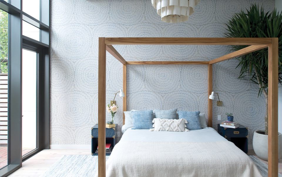 Schumacher's new textured wallpaper in a master bedroom adds to the layering of the room